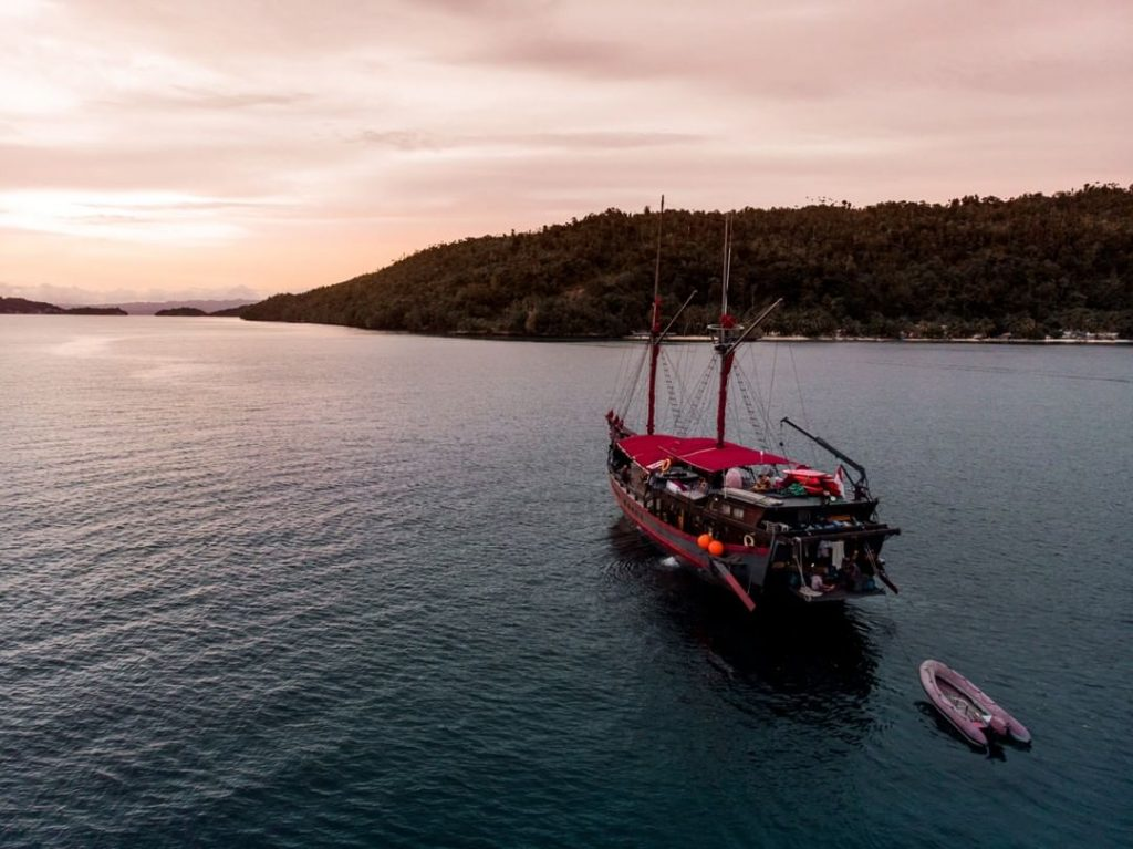 A Komodo boat trip under pink sky
