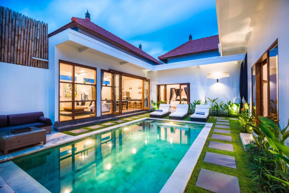 villa Seminyak, with a private pool and lazy chairs, pampering you to enjoy holiday
